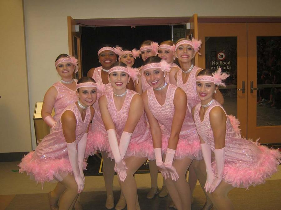 Faith Lutheran's high school dance team are prepared to perform at the high school lip-sync. In pink feathered dresses, the dance team consumes went along great with the them of the week