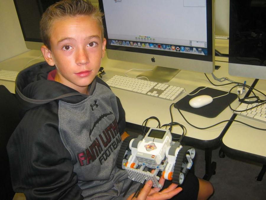 Student Nick Phillips displays his robot.