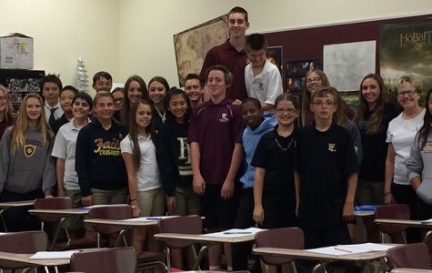 The maroon class of Why We Believe poses for a picture in their classroom. Krafft created Why We Believe to make students more confident in their relationship with Jesus and become able to defend their very own faith.
