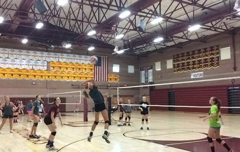 Hanna Karl, seventh grader, gets ready to hit the volleyball as her fellow teammates watch.