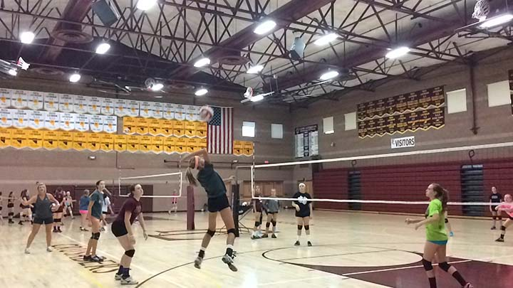 Hanna+Karl%2C+seventh+grader%2C+gets+ready+to+hit+the+volleyball+as+her+fellow+teammates+watch.+