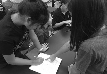 Students Caroline Hsu and Nicola Talpot work hard on coming up with new ideas. They stay focused and are working together to complete the task.