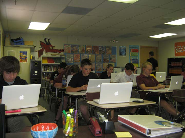 Students work on their computers during Journalism class. This class allows students to thrive under pressure.
