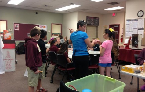 Cupcake Club's first meeting after school. Mrs. Vartouhi Asherian and her daughter Naree Asherian, help out members in Cupcake Club.