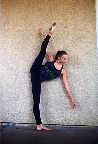 Lee shows off her tilt, a move that involves performing a vertical standing split. A tilt requires extreme dedication.