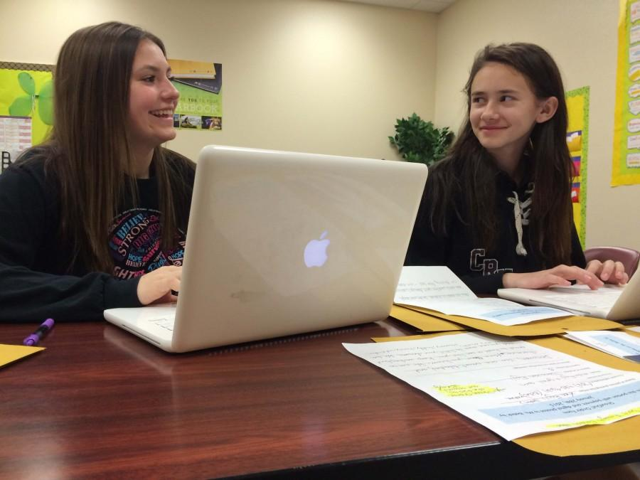 Eighth grader Jordan Leal and seventh grader Evelyn Rossmann continue to work on the yearbok pages before the deadline. With these videos, this year's yearbook will give students different ways of looking back on the year.