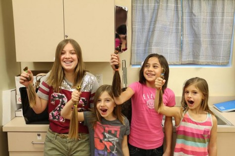 Girls who participated in the Student Leadership class's cause proudly show off their ponytails. They were four of the ten girls who donated