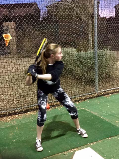 Madison Correia practices her batting abilities with her batting coach in Faith Lutheran's batting cages. Holding Faiths' school team softball tryouts on Feburary 21 was the start of Faith's school softball season for many high school players.