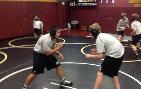 Students wrestle competitively in Faith Lutheran's wrestling room. The students say that wrestling is like none other sport that they have played.
