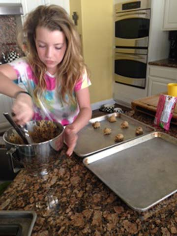 Eight grader Kelsie Seigle, works on baking cookies for her service project. The project occured at an assisted living home over Valentine's day.