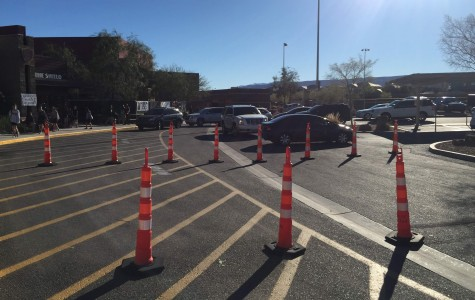 Photo of cars going through Faith Lutheran back parking lot following the path of the directed cones. This shows how crowded the parking lot can get.