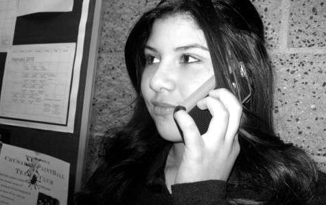 Talina Hajar listens to a cellphone call from a friend. Cellular devices can emit radiofrequency waves that can lead to a higher risk of cancer.