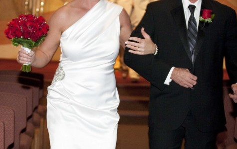 """Mr. and Mrs. Harper walk down the aisle after saying, """"I do."""" The newlyweds got married on Decemember 30, 2014 at Faith Community Lutheran Church."""