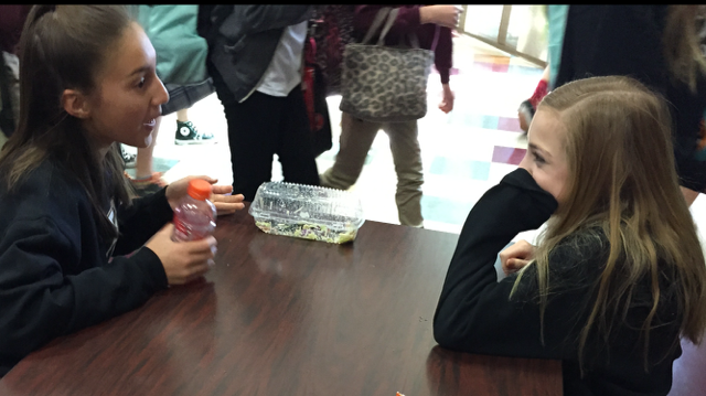Students put down their phones during lunch and talk to each other. Many administrators say that students have been following the new rule well.