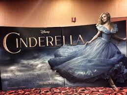 In the poster above shows Cinderella during a scene in the movie. The poster shows Cinderella in a beautiful dress which puts together the whole look.