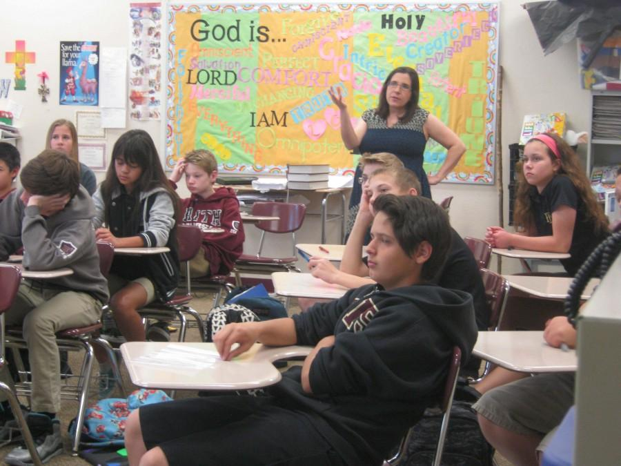 Mrs. Wiltse teaches her seventh grade students about the Old Testament. Next school year, Mrs. Wiltse will teach part time, so she can take care of the baby.