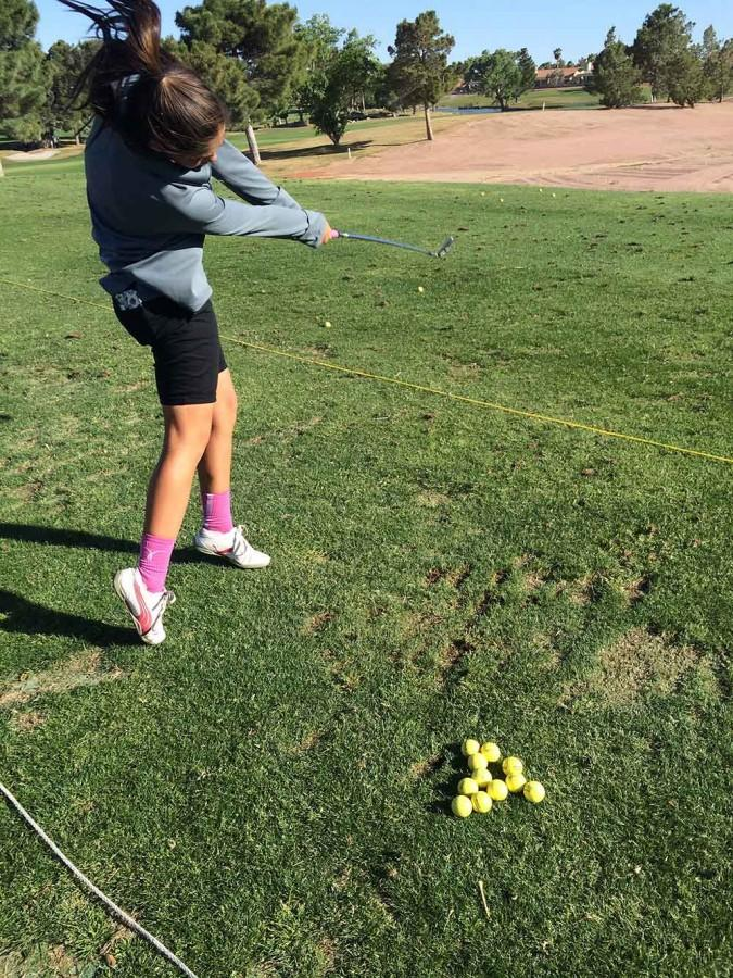 Golf+team+member+Meghan+Singh+practices+her+swing.+The+golf+team+works+everyday+to+get+better+and+win+for+their+school+and+show+their+pride.