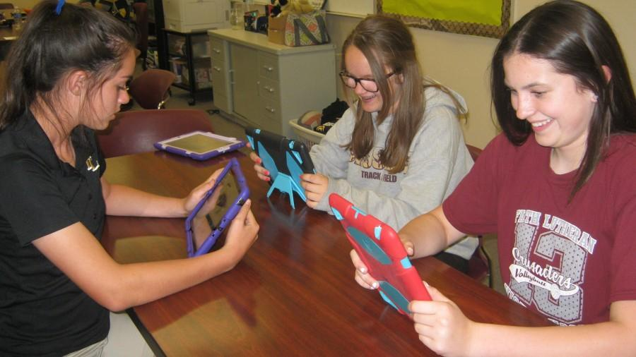 iPads have become quite useful for classroom activities, such as the English project that these eighth graders work on. Faith will allow the eighth grade students to purchase their iPads for $150 at the end of the school year.