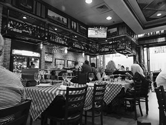 Family and friends dinning at Grimaldi's restaurant at the South Rainbow location. Serving you with fine dinning and delicious pizza.