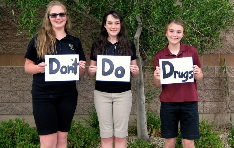 "Hailey Hines, Ireland Otto, and Alexandra Mojado pose for a picture, holding ""Dont Do Drugs"" signs. Illegal drugs can ruin lives and destroy future ambitions, in an instance."