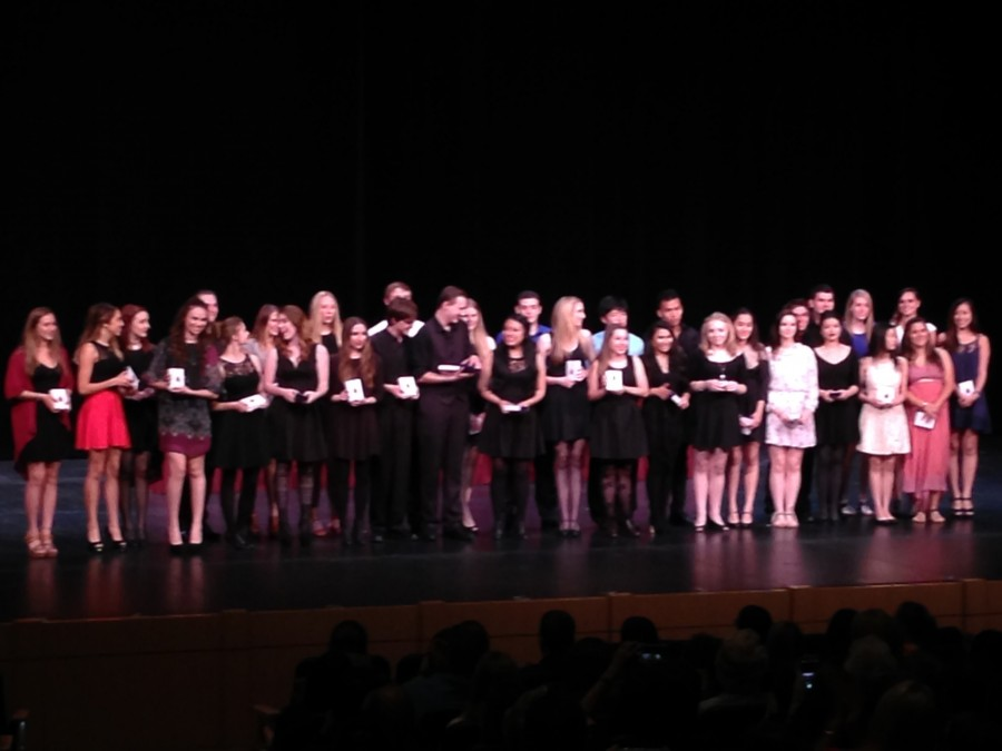 Faith's Conservatory of the Fine Arts seniors receive their graduation medals. The medals honor each senior's participation in the Conservatory.