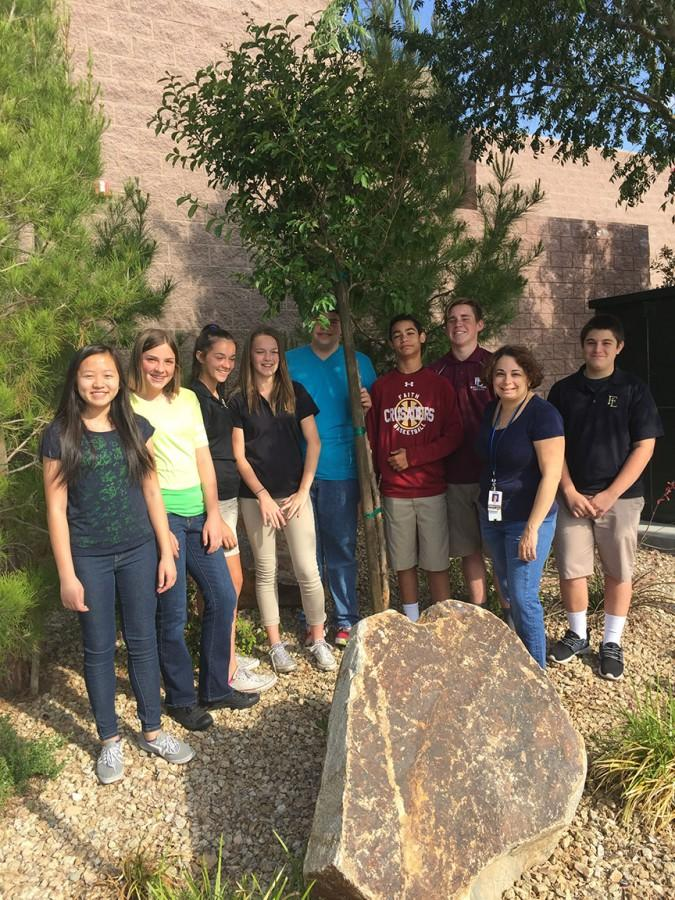 The Water for Life class celebrates the tree they planted near the front office. The picture shows the class's appreciation for the Earth.