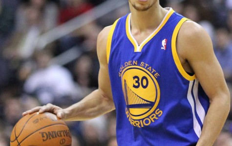 Stephen Curry, the league's MVP, handling the ball during the 2015 NBA playoffs. His team, the Golden State Warriors, are favored to be the NBA Champions for the 2014-2015 basketball season.