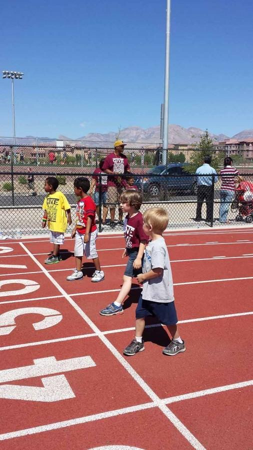 Students from Faith's feeder schools line up at their starting places and await the signal to begin racing. Each student can compete in up to five events at the track meet.