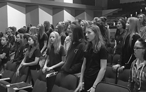 The first and second sopranos of the Middle School choirs warm up to rehearse their few selected songs for their adjudication in May. Many of the girls have faces full of smiles, knowing of the fun trip ahead on May 13.