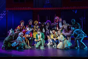 "The cast of ""Pippin"" gathers around during a scene in the play. ""Pippin"" was performed on May 8-17 as the final show for the 2014-2015 drama season."