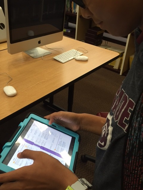 Seventh grader, Megan Bocobo uses the Shelf It app to access her books. This allows her to use her textbooks whenever and wherever.