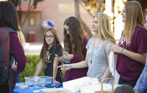Hailey Gravitt and Katie Crowder sell donuts to the students at Faith Lutheran on a Friday morning. This fundraiser took place every Friday of Septmeber to raise awareness for Type 1 Diabetes at Faith Lutheran.