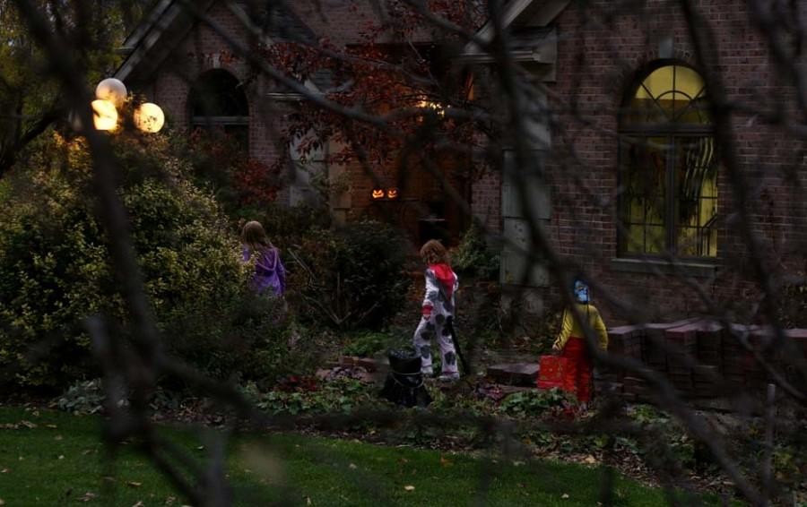 Trick-or-treaters+on+Halloween%2C+having+fun+with+their+friends.+They+hope+they+can+trick-or-treat+forever%2C+but+sadly+once+they+are+middle+school+there+parents+will+tell+them+they+are+too+old.