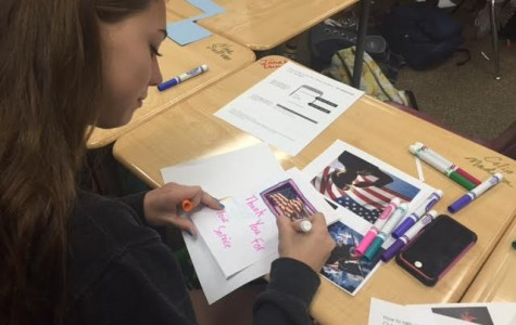 Eighth grader Isabelle Cottingham makes a card thanking veterans for their service. Builder's club makes these cards for their November service event.