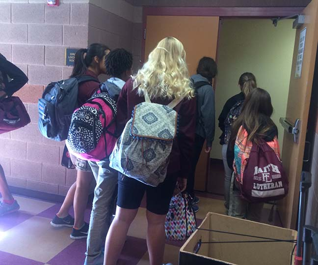 Faith Lutheran students walk into the girls' locker room to get ready for PE class. This change has caused students to alter their way of getting ready.
