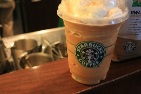 A pumpkin spice latte purchased from Starbucks. Starbucks and other coffe shops offer pumpkin spice products.