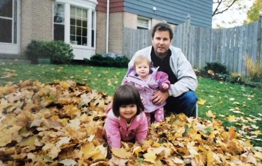 Katie Youngson and her family play in the leaves, on Canadian Thanksgiving, before her dad makes dinner. This photo was taken when Youngson and her family lived in Canada.