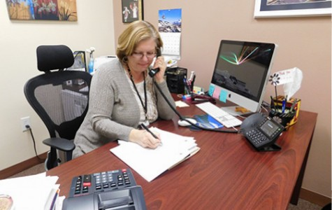 Linda Tayrien, Chief Financial Officer of Faith Lutheran, fills out paperwork. If the Educational Savings Account Bill proceeds, Faith Lutheran might see an increase in enrollement and an impact in the admissions department.