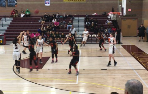 Sophomore Madison Bocobo shoots a three point shot against Mojave High School. Faith's varsity girls basketball team along with the rest of the high school will move up to Division 1 starting in the 2016-2017 year.