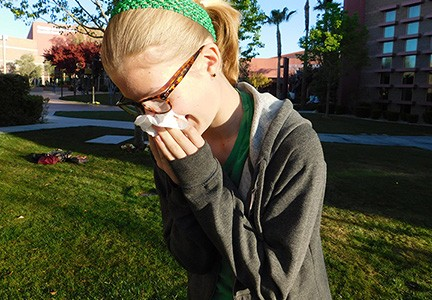 Margo Williams sneezes into a tissue. Nevada has some of the worst seasonal allergy symptoms due to the amount of dust, dry terrain and heat.