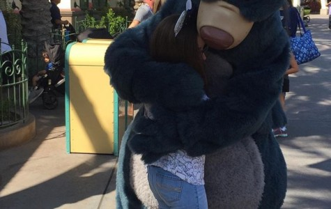 This picture shows eighth grader, Mckenna Carlson, meeting Baloo in Disneyland. Not only did prices go up, but the parks have added higher secruity to ensure safety of guests.