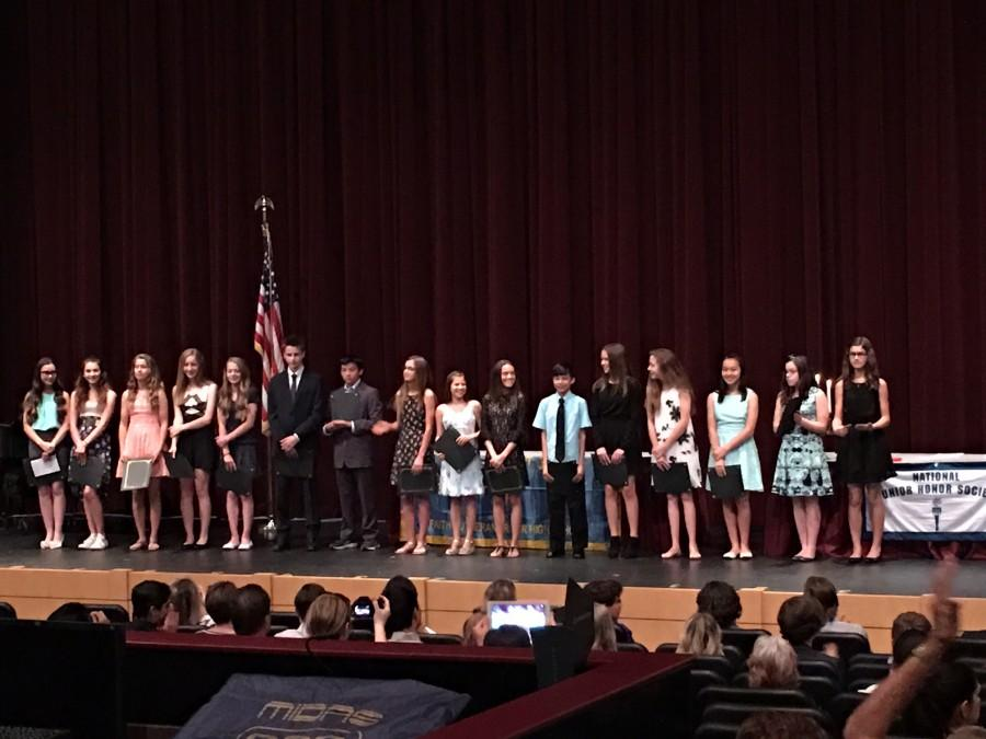 The 17 new members of NJHS stand on the stage after being officially inducted into the club. The induction cermony took place on April 20 at 6:30.