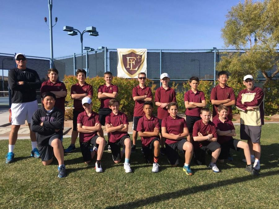 the boys middle school tennis team pose for a picture. Tennis Matches begin in aril and end in mid may.