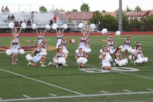 The Faith Lutheran middle school dance team performs at a middle school football game. The dance team's season recently ended so now many students practice and train with dance teams outside of school at various studios.