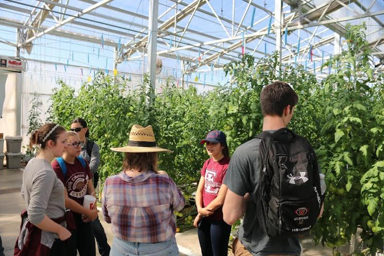 Faith students observe the University of Arizona's greenhouse technology. Currently, these students are in the process of creating plans for Faith's greenhouse.