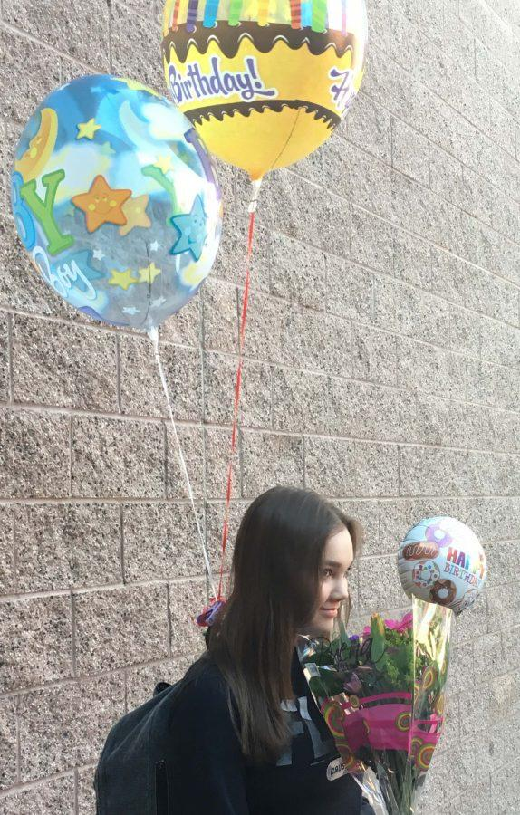 Eighth+grade+student+Emily+Smith+celebrates+her+birthday+with+flowers+and+balloons+from+her+friends+at+school.+Students+with+summer+birthdays+at+Faith+Lutheran+try+to+celebrate+their+birthdays+with+their+friends+before+the+school+year+is+over.