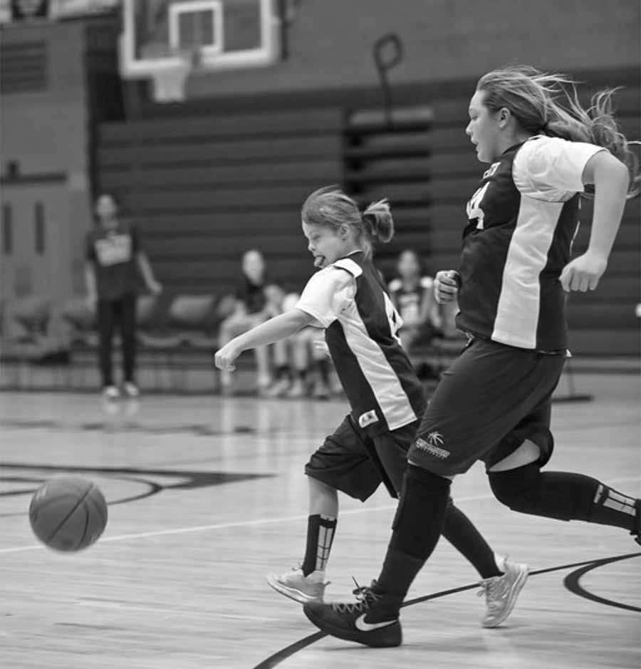 Roberts and another teammate chase after the ball to gain possesion during a Faith home game. Roberts worked hard in practice to compete her best in games.
