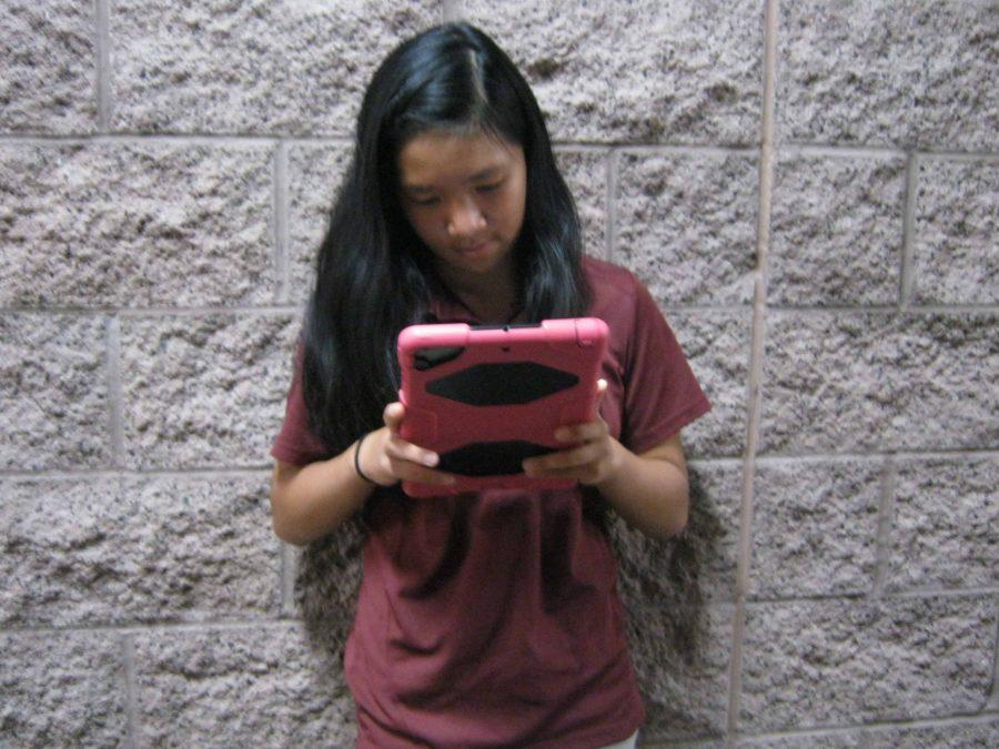 Student, Emily Fung, works on her iPad during class. Some students' cases are falling apart, while others are still intact. If students take good care of their devices, the cases should last until they graduate.