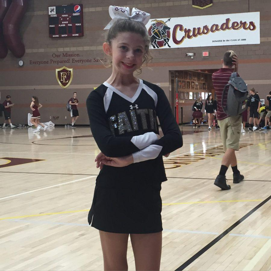 Courtesy of Cindy Seigle Lydia's first assembly with the cheer team. She was put in so much joy, because of the love and support her teammate showed her.