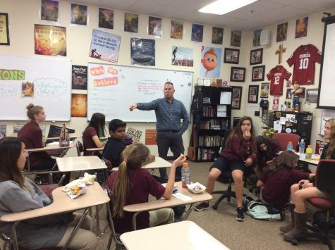 Students gather in Room 116 to discuss a devotional. The group explores new concepts in faith, and informs members of new ways to talk Gospel.